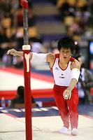 Oct 17, 2006; Aarhus, Denmark; Hiroyuki  Tomita of Japan lands dismount on parallel bars during men's gymnastics team qualifying competition at 2006 World Championships Artistic Gymnastics.