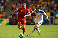 Toby Alderweireld of Belgium and Maksim Kanunnikov of Russia