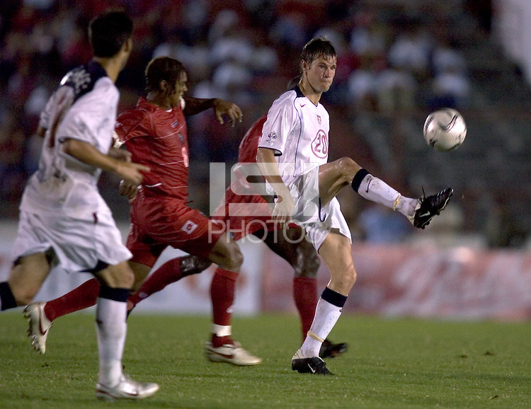 Brian McBride kicks the ball during a 3-0 victory over Panama in Panama City, Panama, Wednesday, June 8, 2005. The USA won 3-0.