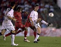 Brian McBride kicks the ball during a 3-0 victory over Panama in Panama City, Panama, Wednesday, June 8, 2005. The USA won 3-0.