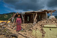 Nepal, Kavre District, Nala, earthquake relief efforts. Visiting destroyed homes on TEWA project supported by Global Fund for Women.  Nirmala, in front of their destroyed home. TEWA is now helping to financially support them.