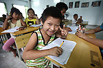 A boy flashes the peace sign while practicing how to write the Vietnamese alphabet at a center for children affected by dioxin exposure in the village of Hoa Nhon, near Da Nang, Vietnam.The Da Nang Association of Victims of Agent Orange/Dioxin says that more than 1,400 children around the city suffer from mental and physical disabilities because of dioxin exposure, a legacy of the U.S. military's use of Agent Orange and other herbicides during the Vietnam War more than 40 years ago. About 60 children attend the Hoa Nhon center each day. Many of them have mental disabilities, while others cannot hear or speak. It usually takes a new child about a year to learn how to interact with other children, says Phan Thanh Tien, the association's president. Staff members try to teach the children to read and write, sew clothes, make handicrafts and help their families raise crops and livestock. Children who cannot hear or speak are taught sign language. The Vietnam Red Cross estimates that 3 million Vietnamese suffer from illnesses related to dioxin exposure, including at least 150,000 people born with severe birth defects since the end of the war. The U.S. government is paying to clean up dioxin-contaminated soil at the Da Nang airport, which served as a major U.S. base during the conflict. But the U.S. government still denies that dioxin is to blame for widespread health problems in Vietnam and has never provided any money specifically to help the country's Agent Orange victims. May 29, 2012.
