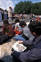 APR 2002, ARGOSTOLI (Cefalonia): studente italiano con la foto di un parente disperso a Cefalonia.APR 2002, ARGOSTOLI (Cephalonia): Italian student with a photo of a missing relative in Cephalonia.