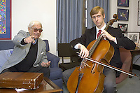 Aldo Parisot with his student Peter Dzialo. Having a little fun and a photo op. 26 April 2004