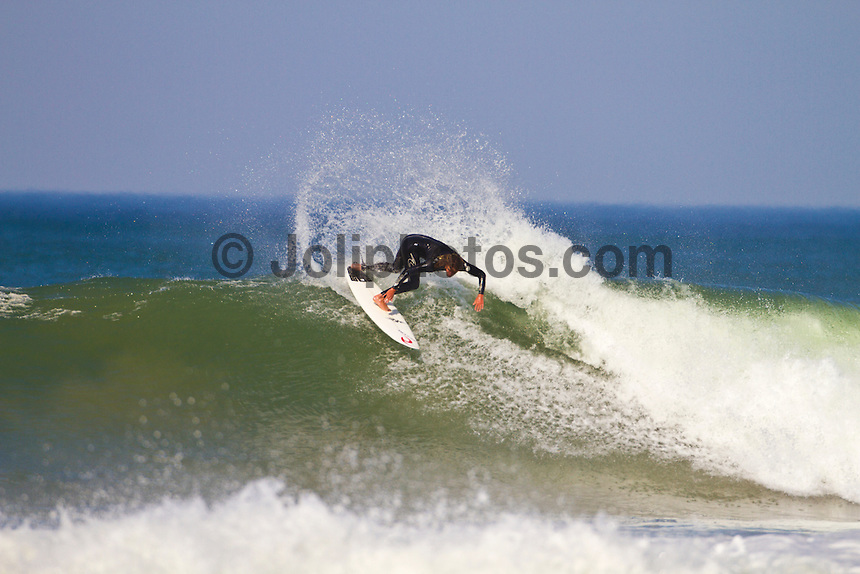 Friday July 9, 2010. Matty Wilkinson (AUS). Free surfing at Jeffreys Bay, Eastern Cape, South Africa.  The swell is in the 5'-6' range with a howling north west devil wind. Photo: joliphotos.com
