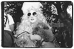 1989:  A portrait of drag queen Sister Dementia holding her poodle  at Wigstock, an annual outdoor drag festival in Thompkins Square Park in New York City.