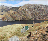 BNPS.co.uk (01202 558833)<br /> Pic: GeoffAllan/BNPS<br /> <br /> This remote lochside bothy in Oban on the Western Highlands offers shelter for two.<br /> <br /> Views with rooms. - New book reveals the remote 'bothies' that lie hidden in some of Britain's most spectacular locations.<br /> <br /> Nestled away in the beautiful remote wilderness of Scotland are a network of secluded mountain huts - known as bothies - where walkers can stay the night before heading to pastures new.<br /> <br /> What is so special about these quaint outposts in some of the most idyllic and untouched landscapes north of the border is that they are completely free to use.<br /> <br /> As a result, the location of many bothies has been a closely guarded secret with visitor centres reluctant to advertise their whereabouts for fear they become overcrowded.<br /> <br /> But in his new book, The Scottish Bothy Bible, author and photographer Geoff Allan has listed more than 80 of them in a bid to make them known to a wider audience.
