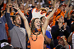 SHOT 10/19/14 7:56:04 PM - A female Denver Broncos fan celebrates a sack with other fans against the San Francisco 49ers at Sports Authority Field at Mile High Sunday October 19, 2014 in Denver, Co. The Broncos beat the 49ers 42-17.<br /> (Photo by Marc Piscotty / &copy; 2014)