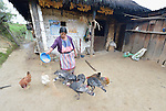 Audelina Vasquez Lopez, a Maya Mam woman, feeds her poultry in front of her home in Tuixcajchis, a small village in Comitancillo, Guatemala.