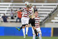 Houston, TX - Friday December 11, 2016: Jared Gilbey (15) of the Stanford Cardinal wins a header over Ian Harkes (16) of the Wake Forest Demon Deacons at the NCAA Men's Soccer Finals at BBVA Compass Stadium in Houston Texas.