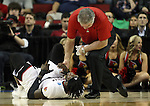 Louisville's trainer attends to Montrezi Harrell (24) after getting hurt in the Cardinals game against Northern Iowa State during the 2015 NCAA Division I Men's Basketball Championship's March 22, 2015 at the Key Arena in Seattle, Washington.  Louisville beat Northern Iowa State 66-53 to advance to the Sweet 16.  ©2015. Jim Bryant Photo. ALL RIGHTS RESERVED.