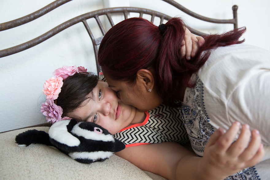 """Ana Ximena Navarro (L) is pictured with her aunt Gabriela Rios Ballesteros (R), at her home in Guadalajara, Mexico on February 22, 2017. Ximena was diagnosed as an infant with Hurler syndrome. Hurler syndrome is the most severe form of mucopolysaccharidosis type 1 (MPS1), a rare lysosomal storage disease, characterized by skeletal abnormalities, cognitive impairment, heart disease, respiratory problems, enlarged liver and spleen, characteristic facies and reduced life expectancy. Ximena was being given enzyme replacement therapy (ERT) when she was 19 months old, and she was suddenly able to eat and sleep. She is now 12, and has normal hormonal development for her age, although some mental delay, according to her father. """"Without the treatment, she would have died from all the complications — untreated, children have a very bad quality of life and typically die before they are seven"""", her father says. Photo credit: Bénédicte Desrus"""