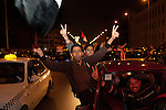 "Egyptians cheer and chant ""Freedom"" atop cars along the 6th of October corridor in downtown Cairo after hearing the news that Egyptian President Hosni Mubarak had stepped down February 11, 2011 following momentous marches on the public buildings across Cairo, Egypt. (Photo by Scott Nelson)"