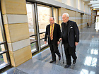 Kroc Institute director Scott Appleby and President Emeritus Rev. Theodore M. Hesburgh, C.S.C. walk in the Hesburgh Center...Photo by Matt Cashore/University of Notre Dame