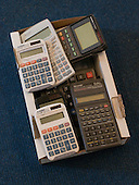 Calculators ready for a GCSE Maths exam, state secondary school.