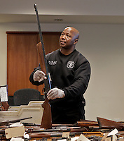 New Jersey, United States. 19th Feb, 2013. A police member organizes weapons displayed to the media after being acquired during the Gun Buyback program, last weekend, in the Essex county in New Jersey. Photo by Kena Betancur / VIEWpress.