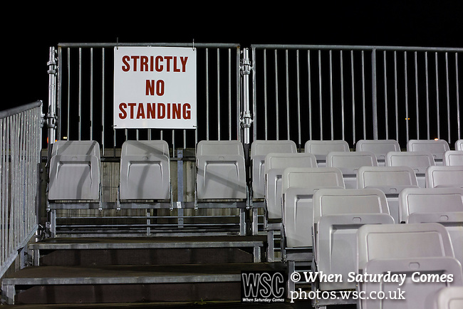 Bishop Auckland 3 West Auckland Town 1, 22/01/2016. Heritage Park, Northern League Division One. A sign saying 'strictly no standing' in seating behind the goal, pictured before Bishop Auckland host West Auckland Town in a Northern League division one match at Heritage Park. Bishop Auckland were winners of the Amateur Cup 10 times between 1895 and 1957 whilst their opponents won the Sir Thomas Lipton Trophy, regarded as the first world club tournament, in 1909 and 1911.  Bishop Auckland won this fixture 3-1, watched by a crowd of 422 at the ground they moved into in 2010. Photo by Colin McPherson.