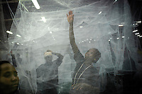 Workers in the &quot;A to Z&quot; long-lasting insecticide-treated bed net factory, the biggest net facory in Africa.