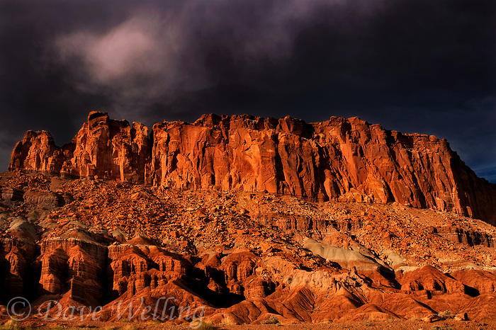 731350272 dark storm clouds above the fluted wall sandstone formations in capitol reef national park utah united states
