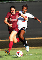 WINSTON-SALEM, NORTH CAROLINA - August 30, 2013:<br />  Christine Exeter (22) of Louisville University loses the ball to Jordan Coburn (19) of Virginia Tech during a match at the Wake Forest Invitational tournament at Wake Forest University on August 30. The game ended in a 1-1 tie.