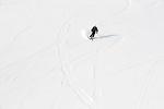 A skier/snowboarder descends on a run at Grand Hirafu resort in the Niseko ski region of Hokkaido, Japan on Feb. 9 2010. Winds from Siberia howl across the Sea of Japan, bringing in some 15 meters of powdery snow to Niseko each year.