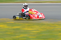 Darryl Currie, 47, races in the Rotax Heavy class during the 2012 Superkart National Champs and Grand Prix at Manfeild in Feilding, New Zealand on Saturday, 7 January 2011. Credit: Hagen Hopkins.