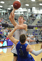 NWA Democrat-Gazette/ANDY SHUPE<br /> Fayetteville guard Tyler Roth (1) takes a shot over Rogers  guard Jake Benninghoff (3) Friday, Feb. 10, 2017, during the first half of play in Bulldog Arena. Visit nwadg.com/photos to see more photographs from the game.