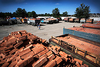 Trucks loaded with bricks at a storage facility. After the war there were no buildings left standing, now Turkish contractors build new buildings funded by Russia. The city is undergoing rapid regeneration.