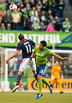 Seattle Sounders Gonzalo Pineda (8) heads the ball away from New England Revolution Kelyn Rowe (11) during an MLS match on March 8, 2015 in Seattle, Washington.  The Sounders beat the Revolution 3-0.  Jim Bryant Photo. ©2015. All Rights Reserved.