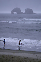 August 18, 2008 :  Children played on the beach of Rockaway, Oregon during an afternoon rain storm.  The Oregon beaches are tourist attractions during the summer months.