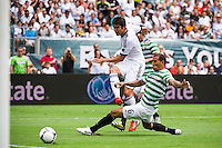 Kaka (8) of Real Madrid shoots as Kelvin Wilson (6) of Celtic F. C.defends during a 2012 Herbalife World Football Challenge match at Lincoln Financial Field in Philadelphia, PA, on August 11, 2012.