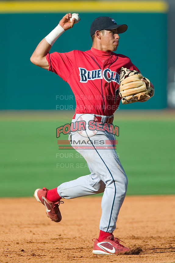 Lakewood shortstop Fidel Hernandez makes a throw to first base versus Greensboro at First Horizon Park in Greensboro, NC, Sunday, July 16, 2006.  The Grasshoppers defeated the BlueClaws 7-4.