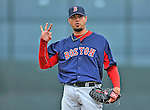 8 March 2012: Boston Red Sox pitcher Josh Beckett works on some singaling during a Spring Training game against the St. Louis Cardinals at Roger Dean Stadium in Jupiter, Florida. The Cardinals defeated the Red Sox 9-3 in Grapefruit League action. Mandatory Credit: Ed Wolfstein Photo