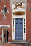 A brick house and a blue door in Beacon Hill in Boston, MA.
