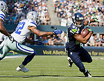 Seattle Seahawks'  wide receiver Doug Baldwin ,right, runs for a first down after catching a pass against Dallas Cowboys' free safety Gerald Sensabaugh , center, and strong safety Mana Silva at CenturyLink Field in Seattle, Washington on September 16, 2012. The Seahawks beat the Cowboys 27-7.     ©2012. Jim Bryant Photo. All Rights Reserved...