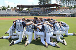 02 June 2016: Nova Southeastern players huddle before the game. The Nova Southeastern University Sharks played the Cal Poly Pomona Broncos in Game 11 of the 2016 NCAA Division II College World Series  at Coleman Field at the USA Baseball National Training Complex in Cary, North Carolina. Nova Southeastern won the semifinal game 4-1 and advanced to the championship series.