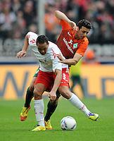 FUSSBALL   1. BUNDESLIGA   SAISON 2011/2012   29. SPIELTAG 1. FC Koeln - SV Werder Bremen                           07.04.2012 Ammar Jemal (li, 1. FC Koeln) gegen Claudio Pizarro (re, SV Werder Bremen)