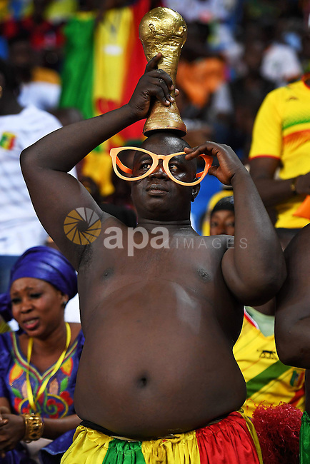 A Mali supporter poses with a replica of the FIFA World Cup trophy during the 2017 Africa Cup of Nations group D football match between Mali and Egypt in Port-Gentil on January 17, 2017. Photo by Stranger