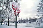Heavy snow hangs on trees and bushes, and a stop sign near Wingra Creek after 14-inches of snow blanked the Madison, Wisconsin area December 9, 2009.