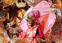 Dancers in ornate colourful national costumes at a carnival in Trinidad