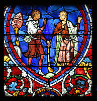 The younger son arrives home, meets his father and begs his forgiveness, the father gestures in surprise and joy. The Return of the Prodigal Son, from the Parable of the Prodigal Son stained glass window, in the north transept of Chartres Cathedral, Eure-et-Loir, France. This window follows the parable as told by St Luke in his gospel. It is thought to have been donated by courtesans, who feature in 11 of the 30 sections. Chartres cathedral was built 1194-1250 and is a fine example of Gothic architecture. Most of its windows date from 1205-40 although a few earlier 12th century examples are also intact. It was declared a UNESCO World Heritage Site in 1979. Picture by Manuel Cohen