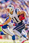 12 October 2014: New England Patriots wide receiver Julian Edelman evades a tackle during a game against the Buffalo Bills at Ralph Wilson Stadium in Orchard Park, NY. The Patriots defeated the Bills 37-22 to move into first place in the AFC Eastern Division. Mandatory Credit: Ed Wolfstein Photo *** RAW (NEF) Image File Available ***