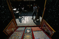 Show-window of Thangka in Durbar Square in Kathmandu. The lamas who paint thangkas use painting as a form of spiritual education and can spend up to 9 months on each canvas..Thangkas are seen hanging in every temple, monastery and family shrine in Tibet and Nepal.