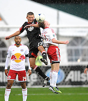 D.C. United midfielder Kitchen Perry (23) heads the ball against New York Red  Bulls midfielder Dax McCarty (11) D.C. United defeated The New York Red Bulls 4-1 at RFK Stadium, Sunday April 22, 2012.