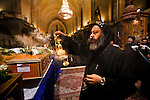 An Egyptian Coptic cleric leads prayer over the coffins of the victims of sectarian violence during an October 10, 20011 funeral  at the Coptic Cathedral  in Cairo, Egypt. At least 26 people, mostly Christian, were killed during sectarian clashes that saw the worst violence since the Revolution that toppled former Egyptian president Hosni Mubarak earlier this year. Egyptian Coptic Christians make up about 10% of Egypt's 80 million population and periodically violence flares between the Christian minority and the majority Muslim population. (Photo by Scott Nelson)