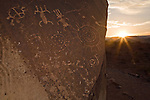 Petroglyphs at the Little Black Mountain Petroglyph Site watch the sun rise over the Hurricane Cliffs