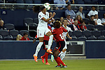 15 October 2014: Christen Press (USA) (14) heads the ball over Brianna Ryce (TRI) (16). The United States Women's National Team played the Trinidad and Tobago Women's National Team at Sporting Park in Kansas City, Kansas in a 2014 CONCACAF Women's Championship Group A game, which serves as a qualifying tournament for the 2015 FIFA Women's World Cup in Canada. The United States won the game 1-0.