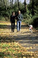 Couple walking dog, Washington