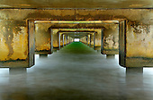 View under the concrete pilings of the pier at Hanalei, Kauai, Hawaii, USA.