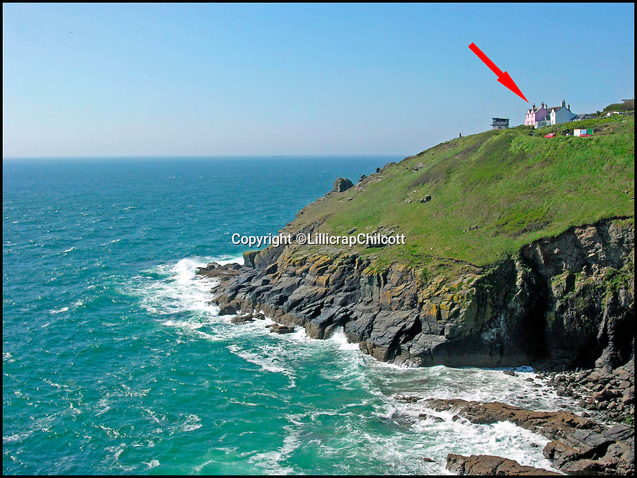 BNPS.co.uk (01202 558833)<br /> Pic: LillicrapChilcott/BNPS<br /> <br /> Where the house is located in Bass Point (pink house).<br /> <br /> Next stop Spain!<br /> <br /> A rare chance to own the most southerly house in Britain nestled on a rocky outcrop overlooking the English Channel has arisen - but prospective buyers will have to rustle up &pound;575,000 to get their hands on it.<br /> <br /> The secluded two-bed terraced house would be ideal for those looking to be at one with nature - because it sits on the tip of Bass Point at The Lizard in Cornwall, the most southerly part of mainland Britain.<br /> <br /> Once a coastguard cottage, it offers sweeping 180 degree views of the rugged coastline and is so exposed to the elements its owners say sitting in the lounge feels like being out at sea.<br /> <br /> If you were to travel due south of the house the next land you would hit would be Santander in Spain.